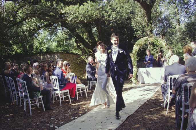 arch of flowers Tuscan wedding ceremony