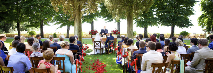 red outdoor wedding ceremony Tuscany